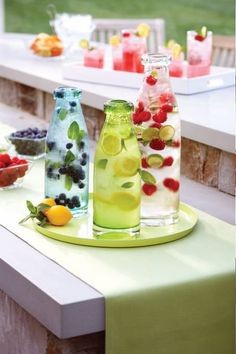 Colorful Lemonade Bar, glass bottle collection, berries, mint. Debi Lilly Design for Safeway / Dominick's.