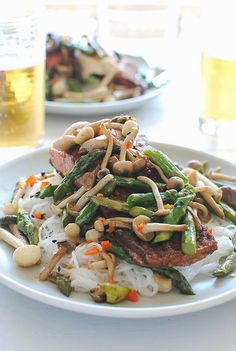 Seared Salmon with Mushrooms and Asparagus over Coconut Noodles / Bev Cooks