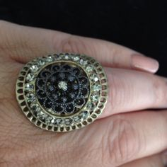 Gold Tone With Black Accent And Clear Stone