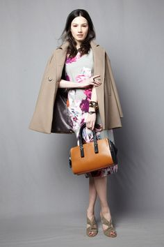 Floral print dress paired with wide-lapel car coat by @Trina Turk. #IStyleNY #Style