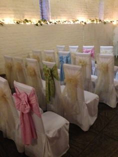 White cotton chair covers Ivory & ditsy floral sashes from Simply bows and Chair covers