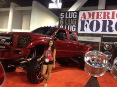 Street Diesel Performances 2014 Ford F450 in the American Force Wheels booth with Model Heather Ouimette at SEMA 2013