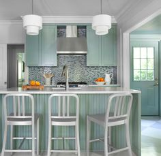 Suzie: Mark Williams Design - Green kitchen cabinets, gray & black glass tiles backsplash, ...