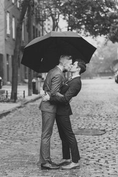 Romantic Gay Wedding Photo under umbrella