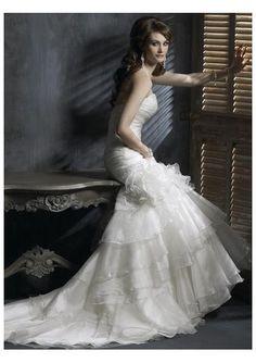 Google Image Result for http://4.bp.blogspot.com/-d0FLST3mKnU/Tmy9zLR13aI/AAAAAAAAAFE/yULevVzHH64/s1600/puffy-wedding-dresses2.jpg