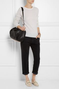Neutral colored loafers for spring and summer styled with black pants, black bag. Tod's   Chain-embellished leather loafers   NET-A-PORTER.COM