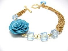 blue rose bracelet - could make orange with orange flower from old necklace, go with asymmetrical necklace