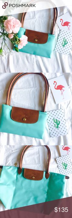 """Longchamp Le Pliage large in lagoon Brand new never used Longchamp le Pliage large size in beautiful lagoon / Tiffany blue color. One of my favorite colors for Longchamp bags. Always sold out quickly, very hard to find!      So pretty and perfect for the summer.  Dimensions: 12 1/4""""W x 11 ¾""""H x 7 ½""""D. (Interior capacity: large.) 9"""" strap drop. Longchamp Bags Totes"""