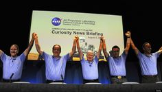 (From L) John Grunsfeld, NASA associate administrator, Richard Cook, MSL deputy project manager, Pete Theisinger, MSL project manager, Adam Steltzner, MSL entry, descent and landing (EDL) lead and John Grotzinger, MSL project scientist from the Mars Science Laboratory (MSL) Curiosity Rover mission team raise their arms at a press conference after the Mars Rover Curiosity successfully landed on the surface of the Red Planet on August 5, 2012 at the Jet Propulsion Laboratory in Pasadena, Ca.