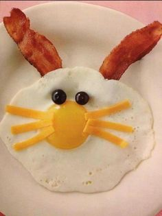 Bunny Breakfast - an egg, bacon ears, cheese for whiskers and blueberries for eyes, cute!