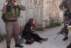 PHOTO: Woman assaulted and arrested by #Israel&#039