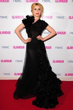 Retro beauty Paloma Faith plumped for this dramatic Nicholas Oakwell Couture black gown for the evening with pretty floral embellishment, complementing her look with a loose up-do and statement eyeliner.