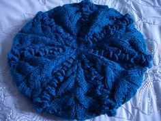 If you love knit hat patterns, but aren't comfortable working with double pointed or circular needles, then you might want to give this pattern a try. Made with vibrant yarn, knit bobbles and a leaf-like design, the Blueberry Crumble Beret is surpri Knitting Designs, Knitting Patterns Free, Knit Patterns, Free Knitting, Knitting Projects, Free Pattern, Knitting Needles, Knitted Headband, Knitted Gloves