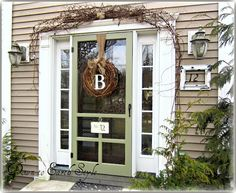 love the wreath and the color of the door (Wethersfiled Moss by Benjamin Moore)