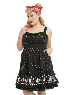 <p>This is the perfect dress to wear for an afternoon of croquet in the garden. But make sure you keep your head, we don't think you'll look quite the same without it! This black empire waistdress features an all over white and red polka dot print with hearts, spades, diamonds and clubs scattered throughout. Accented with a black foldover collar on the sweetheart neckline,a contrasting black band at the waist, black adjustable straps, faux cloth buttons and a back zipper closure....