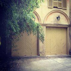 Limestone & Boxwoods - Instagram (@limestonebox) - diamond patterned doors on a carriage house designed by Schutze