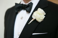 This groom is looking great with his white boutonniere and black bow tie! Photography by Tracy Autem Photography. #wedding #boutonniere #groom