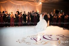 Enhance your wedding's decor with a white dance floor complete with your monogram!