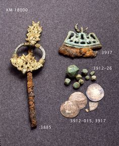 Very elaborate annular brooch / clothes pin, firesteel pendant,  weights and arabic coins found from Finland.