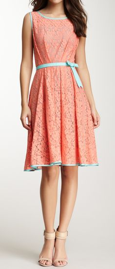 I have a vintage one in this same fabric! Gives me some ideas on sprucing it up! Floral lace dress