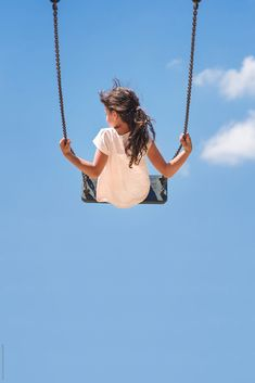 Girl sitting on a swing flying high in the blue sky by Lea Csontos - Stocksy United Swing Photography, Blue Sky Photography, Creative Photography, Lifestyle Photography, Playground Photography, Sky Photos, Girl Photos, Swing Pictures, Toddler Poses
