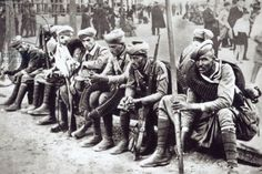 Moorish soldiers fighting for the Nationalists rest in a Castilian marketplace (b/w photo)