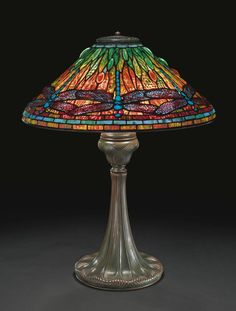 "Lot | Sotheby's PROPERTY OF A LADY TIFFANY STUDIOS ""DRAGONFLY"" TABLE LAMP with a ""Tyler"" base shade with small early tag impressed TIFFANY STUDIOS/NEW YORK base impressed TIFFANY STUDIOS/NEW YORK/368 leaded glass and patinated bronze 26  1/8  in. (66.4 cm) high 20  1/2  in. (52.1 cm) diameter of shade circa 1905 Estimate 90,000 — 120,000 USD  LOT SOLD. 149,000 USD  (Hammer Price with Buyer's Premium)"