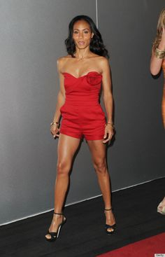 Jada Pinkett Smith Wears A Sexy Red Valentino's Strapless Wool Blend Jumpsuit and accented the look with simple gold bracelets and black sandals,...great bod!