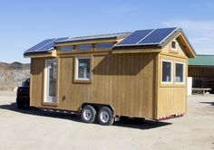 Tiny Home with Solar $40,000 Custom built solar powered tiny home. Our 8'x24' home features 192 square feet of living area, seated on a heavy-duty trailer that is included in the purchase price. It was built using only high quality materials, including pine car siding interior, a ceramic tile shower unit, formica countertops and quality…