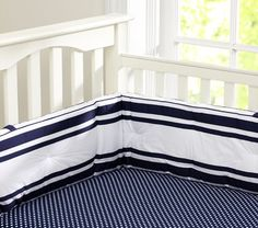 Navy crib sheet with white polka dots - maybe get custom skirt and bumpers on Etsy?