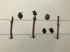 Pebble art I made for a friend. Pebbles are from Middle Cove Beach, NL and the twigs are from a lilac tree in my backyard. #pebbleart #pebbles #bird #birds #fence