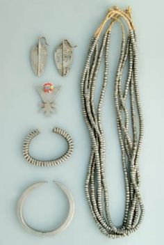 Africa | A collection of jewellery pieces (necklaces, bracelets, earrings and an amulet) from the Samburu, Gabbra and Turkana peoples of Kenya | Aluminium and glass beads