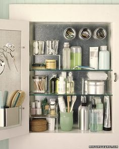 Organize | BATHROOM :: Install a metal back in bathroom cabinet! :: then you can use those Ikea magnetic canisters w/ the clear tops like shown in the upper right corner! Then, add hooks to the back of the mirror for added storage. | #bathroom #bathrooms #medicinecabinet