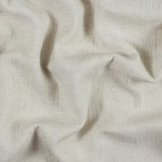 Accompanied by a mug of tea, cozy up with an oversized sweater made of this <strong>Donna Karan Oatmeal Twill Wool Double Cloth</strong>. Warm with a soft hand, this wool is slightly heathered in an easy neutral. Cocoon sweaters, lightweight coats and pullovers can easily be incorporated into your wardrobe. It is thin with a medium weight that provides a thicker drape. Opaque, this fabric does not require a lining. Note that this wool has a very minimal give to it.