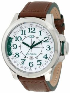 Tommy Hilfiger 1790842 Sport Stainless Steel and Brown leather Watch Tommy Hilfiger. $75.07. White arabic numeral dial with green accents. Stainless steel case and brown leather strap. Water-resistant to 30 M (99 feet). Quartz movement. Durable mineral crystal protects watch from scratches,. Save 29%!