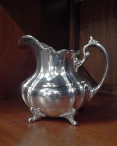 Reed and Barton Sterling Silver Creamer in Hampton Court. Measures 4.5 h.