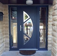 This recent installation combines a textured paint finish with stainless steel door trims and silver anodised hardware to create a perfect contemporary finish -with the wow factor. Grill Door Design, Door Gate Design, Door Design Interior, Entrance Design, Entrance Doors, Grey Front Doors, Modern Front Door, Double Front Doors, Composite Front Door
