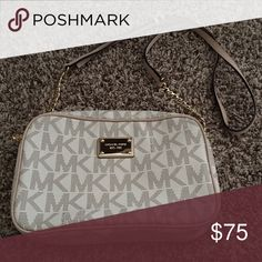 Michael Kors Crossbody Bag Used. Bought it last year and only wore it a handful of times! Still in great condition. Bought from the Michael Kors store. Michael Kors Bags Crossbody Bags