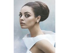 @Byrdie Beauty - The perfect mixture of ballerina chic with a little Audrey Hepburn to boot, this bun oozes sophistication.