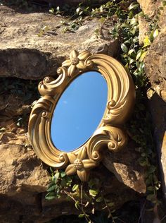 A personal favorite from my Etsy shop https://www.etsy.com/listing/259622628/vintage-gold-ornate-chalkware-mirror