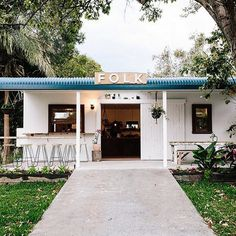 """""""If you want really good coffee, go to Folk! It's attached to a caravan park, and they do amazing coconut lattes! Best coconut latte I've ever had. Coffee Shop Design, Cool Cafe, Remodeled Campers, Byron Bay, Cafe Restaurant, Store Fronts, Pergola, Outdoor Structures, Outdoor Decor"""