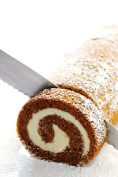 Learn how to make this classic pumpkin roll recipe with a step-by-step photo and video tutorial! It's easy to make ahead of time, it's filled with a heavenly cream cheese filling, and it's always a crowd favorite!!   gimmesomeoven.com