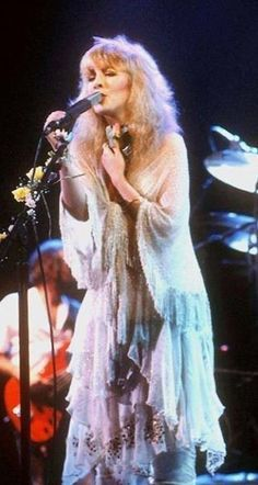 beautiful Stevie onstage, dressed in glittery layered white ~ ☆♥❤♥☆ ~  with a matching shawl that's tied at the bust line