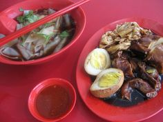 Kway Chap.    Kway Teow is used and served along with almost every part of the pork.  Bean curd and egg are normally used as well. The pork is normally cooked stew Chinese style