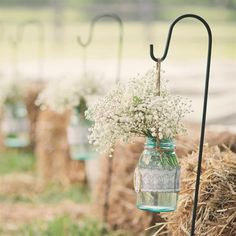 @rachelwegman  Love this idea for an outdoor country wedding. Add coral and bow and more flowers
