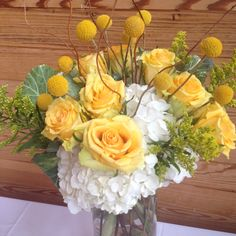 Nothing says spring like the white, yellow and green theme  in this real wedding. #stemsflowermarket #kcweddingflorist #escortcardcenterpiece #yellowweddings #mayweddings #springweddings