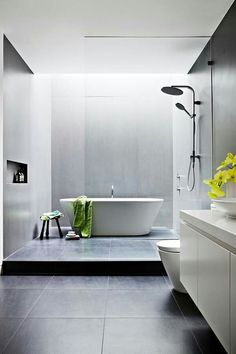 Ceiling Window Bathing Bathroom In Light Stunning Dark Tiles With Timber And White Contrast