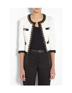 These mini cotton jackets with round necks and embellished trims are very Chanel-esque!