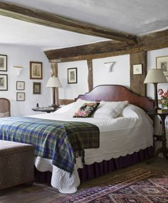 Tartan throw graces a bedroom in an English farmhouse.