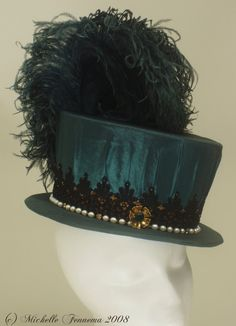 Emerald taffeta, freshwater pearls, vintage brooches, swarovski crystals findings, black lace, mustard taffeta, seed beads, ostrich feathers...
